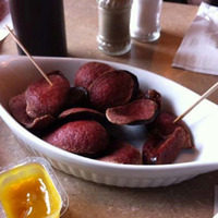 Deep fried pepperoni, always served with honey mustard, photo by Lola Augustine Brown